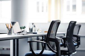 Empty seats in an open plan office